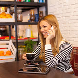 Smiling woman enjoying her free time in coffee shop Stock Photography