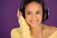 Smiling woman enjoying her music Royalty Free Stock Photos