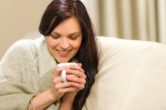 Smiling woman enjoying hot tea Stock Image