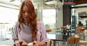 Smiling woman enjoying looking at cakes stock video footage