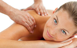 Smiling woman enjoying a massage Royalty Free Stock Image
