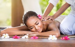 Smiling woman enjoying a massage Royalty Free Stock Images