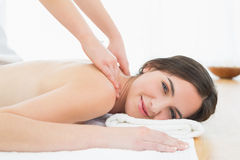 Smiling woman enjoying shoulder massage at beauty spa Royalty Free Stock Photos