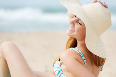 Smiling Woman Enjoying The Sun At The Beach Stock Photography