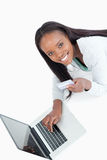 Smiling woman entering credit card information Stock Images