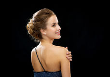 Smiling woman in evening dress from the back Royalty Free Stock Photography