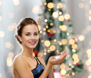 Smiling woman in evening dress with diamond Stock Photography