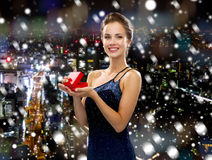 Smiling woman in evening dress with gift box Stock Images