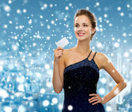 Smiling woman in evening dress holding credit card Stock Photography