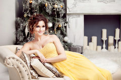 Smiling woman in evening dress  over christmas Royalty Free Stock Images