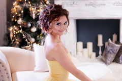 Smiling woman in evening dress  over christmas Stock Photos