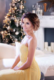 Smiling woman in evening dress  over christmas Royalty Free Stock Photos