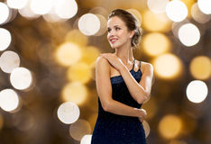 Smiling woman in evening dress and pearl earring Stock Photography
