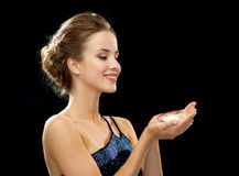 Smiling woman in evening dress Stock Photography