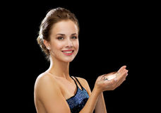 Smiling woman in evening dress Royalty Free Stock Photos