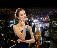 Smiling woman in evening dress Royalty Free Stock Images