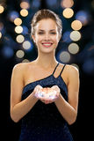 Smiling woman in evening dress Stock Image