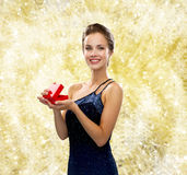 Smiling woman in evening dress with red gift box Royalty Free Stock Image