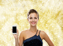 Smiling woman in evening dress with smartphone Royalty Free Stock Images