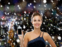 Smiling woman in evening dress with smartphone Stock Photos
