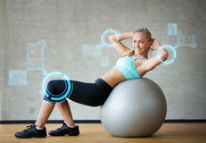 Smiling woman with exercise ball in gym. Fitness, sport, training, future technology and lifestyle concept - smiling woman with exercise ball in gym over virtual Royalty Free Stock Images