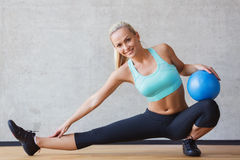 Smiling woman with exercise ball in gym Royalty Free Stock Photo