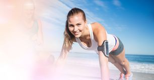 Smiling woman exercising at beach Royalty Free Stock Images