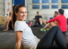 Smiling Woman Exercising In Cross Training Box Stock Photography