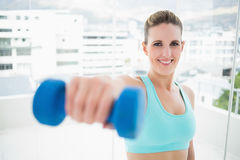 Smiling woman exercising with dumbbell Royalty Free Stock Images
