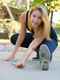 Smiling woman exercising outdoors Royalty Free Stock Photography