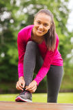 Smiling woman exercising outdoors Stock Photo
