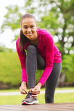 Smiling woman exercising outdoors Royalty Free Stock Image