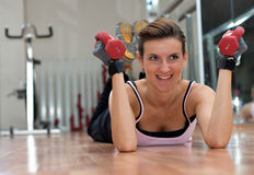 Smiling Woman Exercising with Weights Royalty Free Stock Photo