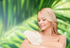 Smiling woman with exfoliation glove Royalty Free Stock Photo
