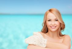 Smiling woman with exfoliation glove Stock Photo