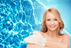 Smiling woman with exfoliation glove Royalty Free Stock Image