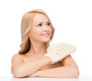 Smiling woman with exfoliation glove Stock Photos