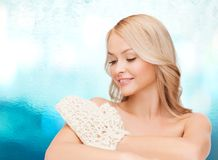 Smiling woman with exfoliation glove Stock Photos