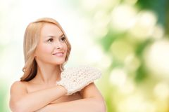 Smiling woman with exfoliation glove Stock Image