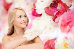 Smiling woman with exfoliation glove Royalty Free Stock Photography