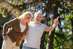 Smiling woman expressing positivity while standing near her husband Royalty Free Stock Images