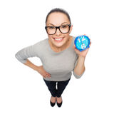 Smiling woman in eyeglasses with blue clock. Time and deadline concept - smiling woman in eyeglasses with blue clock Stock Image