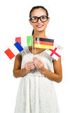 Smiling woman with eyeglasses holding flags Stock Photography
