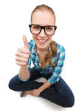 Smiling woman in eyeglasses and showing thumbs up Stock Photography