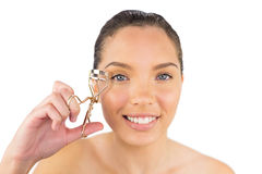 Smiling woman with eyelash curler Royalty Free Stock Photo