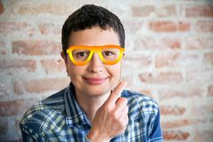 Woman with fake eyeglasses. Smiling woman with fake colored eyeglasses Royalty Free Stock Photo
