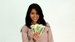 Smiling woman fanning bills stock video footage