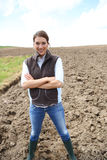 Smiling woman farmer in the fields Stock Photography