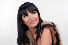 Smiling woman with fashion make up. Fur coat Royalty Free Stock Photos