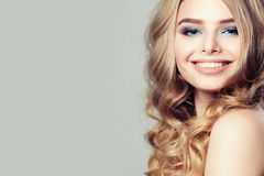 Smiling Woman Fashion Model with Blond Curly Hair Stock Images